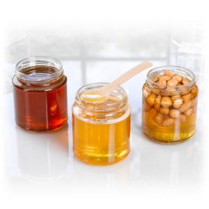 Pots de miels de tilleul, toutes fleurs et nectar d'abeille au romarin et au thym